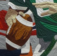 "close up photo:  ""Game Day"" quilt by Debora Barlow. 2014 National Juried Show ~ Canadian Quilters' Association"