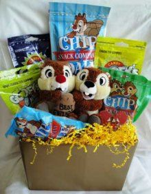 Chip & Dale with Treats Basket - Ideas: Chip & Dale Stuffed Animal, Chip & Dale and Disney Themed Treats; Other ideas for a Fall Themed Chip & Dale basket include pumpkin flavored coffee and treats, mugs, coffee, cocoa, marshmallows, autumn colored/themed dish towels, salt and pepper shakers; Use natural colored/textured ribbon and filler to keep with the fall/chipmunk colors and feel.