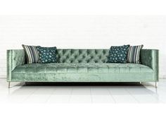 "Upholstered in Brussels Aqua Velvet Fabric, hand tufted and finished with polished brass nail heads and 4"" brass legs. Combining clean lines and a thin frame wi"