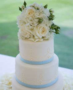 More great cakes by http://www.katymadecakes.co.uk/   Ivory & Blue Wedding Cake