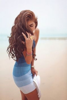 adore the curls and needless to say, the summery tight dress as well!