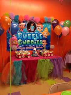 Home made tulle table skirt, bubble guppies banner, Bubble guppies first birthday