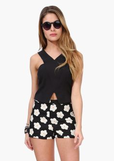 This top has halter style fit with V cut out towards bottom hemline.