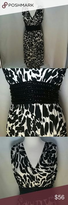 Dress Black and cream floral dress. Beaded waist. Light soft fabric. Flows beautifully with each movement. Zipper in back. Worn only a couple times. Perfect condition. I WILL consider offers less than listed price. Jessica Howard Dresses Strapless