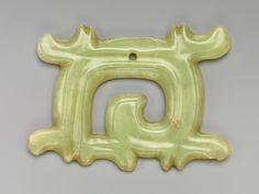Plaque in the shape of a squarish loop with projections [China, Hongshan culture] (2009.176) | Heilbrunn Timeline of Art History | The Metropolitan Museum of Art