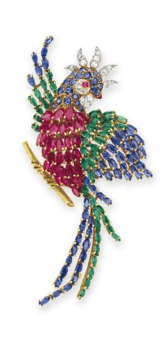 A DIAMOND AND MULTI-GEM PARROT BROOCH Designed as a parrot, with a marquise-cut ruby body, extending marquise-cut sapphire and emerald wings and tail feathers, the circular-cut sapphire head set with a cabochon ruby eye and single-cut diamond detail, mounted in 18k gold and platinum, with French assay marks.