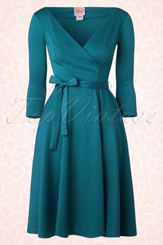 """You can create countless gorgeous looks with this 50s Donna Swing Dress in Teal by Heart of Haute! Dress it up or down, this timeless beauty will never let you down! Beautiful fitted top featuring a sexy V neckline, 3/4 sleeves and a detachable bow tie that accentuates your waist just perfect. From the waist down ending in a semi-swing skirt which hits below the knee with a height of 1.70m / 5'7"""". Made from a soft and supple, stretchy blue/g..."""