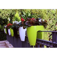Planters that rest over a balcony railing. Description from followpics.co. I…