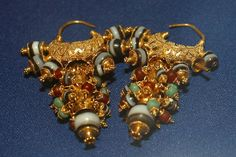 Assyrian Treasures from the city of Kalhu (Nimrud), Earrings of Queen Yaba, wife of King Tiglath-Pileser III, who ruled from c.744-727 BC.    Find Gold ornaments in Queen tombs - Gold Earnings    The Iraqi Museum - Baghdad