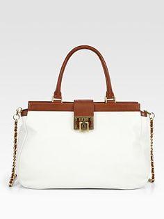 New spring bag? I'm a sucker for white with saddle trim (Tory Burch via SFA)
