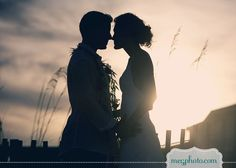 Bridal couple pic - non-kissing silhouettes with tall seeded grass blowing in mid-ground of photo #beach wedding #bride and groom