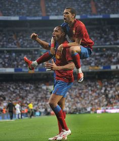 Thierry Henry of Barcelona celebrates with Dani Alves after scoring Barcelona's fourth goal during the La Liga match between Real Madrid and Barcelona at the Santiago Bernabeu stadium on May Get premium, high resolution news photos at Getty Images Real Madrid And Barcelona, Fc Barcelona, Dani Alves, Thierry Henry, Real Madrid Players, Barcelona Football, World Football, Camp Nou, Lionel Messi