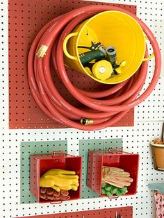Garage organization with or without pegboard. Mount a large bucket to the wall or pegboard to keep the garden hose off the floor and use small bins sideways for items that are not easily hung from hooks (such as gardening gloves and hose nozzles. Garden Hose Storage, Shed Storage, Tool Storage, Garage Storage, Diy Storage, Storage Ideas, Storage Solutions, Extra Storage, Pegboard Storage