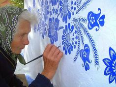 This 87-year old woman loves painting houses. Agnes Kasparkova