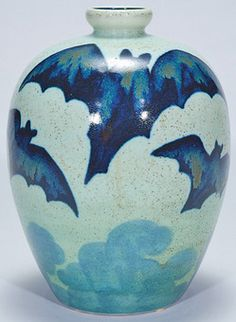 "Boch Freres Art Pottery; Gres Keramis, CATTEAU (Charles), Vase, Bats in Flight, 10"". A Boch Freres ""Gres Keramis"" vase in 3 colors showing 5 bats in flight over a stylized landscape. Marked with the ""Keramis Made in Belgium"" ... (hva)"
