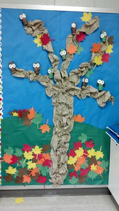 This is the bulletin board Chrisann created for our preschool classroom.  She made it from brown paper towels, then added the leaves to the top of the tree.  She's slowly moved the leaves down as fall has progressed.  I love this tree!