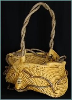 """Mellow Yellow  (2007) - Tina Puckett                    H 29"""" W 23"""" D 21""""                    Framed out of bittersweet and woven with yellow colored reed.                  Branches of bittersweet protrude through the wall of the basket."""