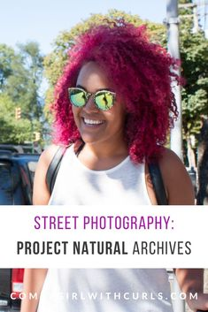 Street Photography Project: Images of Beautiful Black Women wearing their hair natural around the city. This image is a curly-haired woman with dyed pink curls. #BlackWomen #CurlyHair #DyedHair #NaturalHair