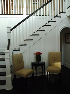 Hmmm.....white newel post and black banisters. Maybe that would work.