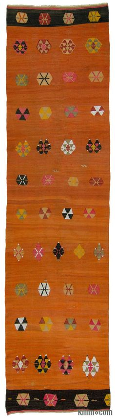 Vintage tribal Turkish kilim runner rug around 70 years old and in very good condition. This orange colored kilim runner was hand-woven in the Sivas region of Central Anatolia, Turkey.