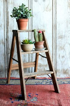 This vintage wood step stool is such a great folding stool for your Rustic Farmhouse decor! It is a folding step ladder that can actually be used as a ladder or as a Rustic plant stand.  Details: ~ Dimensions - 23 inches tall x 12 inches wide. ~ Condition - Very good vintage condition. This Rustic wood stool is sturdy and can be used by an average size adult. There is no damage to the structure. There are paint splatters throughout the top.  Purchase this folding kitchen stool today for a…