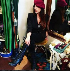 Rachel is so captivating in her beret and boots she scored at the shop today!