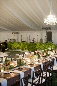 Reception Table with Peach Roses, Greenery and Ferns http://www.busseysflorist.com/wedding-flowers/