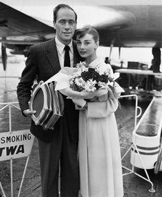 Audrey Hepburn (in Givenchy coat) w/ husband Mel Ferrer