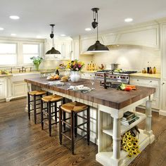 Love! Lighting, butcher block top, island style, bead board, and stools