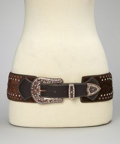 Rock the rustic look with this western-inspired belt. Boasting funky faux fur, gleaming studs and a blinged-out buckle, this bodacious belt is rodeo-ready and runway-approved.