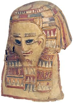 Ancient Egyptian Mummy Mask made from linen and gesso and then painted bright red and browns and highlighted in gold leaf. With staring eyes, the cloth nemes terminating with two cobras, the broad decorative collar with geometrics and lotus flowers, the entire face and arms covered with gold leaf. Surface secured to the linen backing. Once covered the head of the mummy. Ptolemaic. 305-30 BC