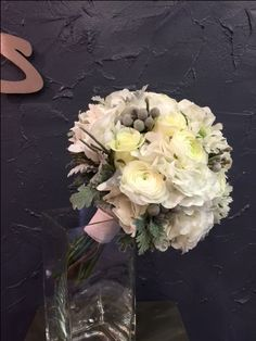 Adorable Bridal bouquet with white Sweet Avalanche roses, white hydrangea, white ranunculus, white scabiosa, silver brunia berries, silver leaves.