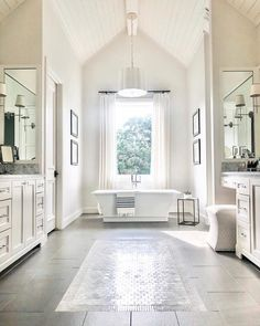 Bathroom goals from my girl 👏🏻👏🏻👏🏻 From the large soaker tub to the tile work and vaulted shiplap ceilings featuring the aged brass sweeny chandelier is perfection. Master Bathroom Layout, Luxury Master Bathrooms, Bathroom Goals, Large Bathrooms, Dream Bathrooms, Modern Bathroom, Bathroom Ideas, Master Suite Layout, Mansion Bathrooms