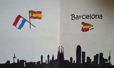 Skyline Barcelona met de vlag van Spanje en van Nederland