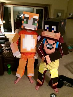 Minecraft costumes, made from foam core and Velcro. I did the graphics in Photoshop, then printed them at an office supply store.  Stampy Longnose and L for Leeeeee