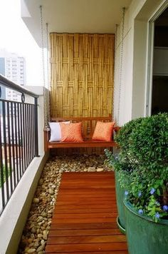 Small balconies in condo's are difficult to decorate, River stones, bamboo screen and lush greens.