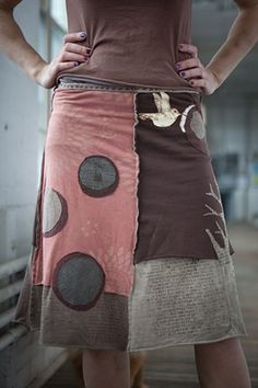 Inspiration!!! Jupiter Girl - recycled t-shirt skirts. No link, but the picture looks like a modified 4-gore skirt with appliqués.
