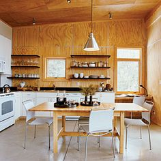 Great ideas for shelves   Make it casual   Sunset.com  Plywood walls stained cherry - add white cafe shelving?
