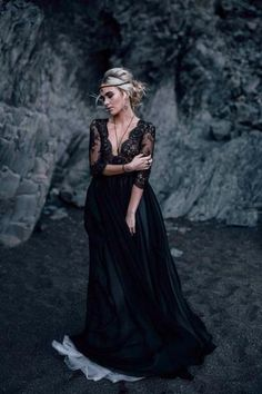 Traditional yet sexy. This gorgeous ball style gown starts with a long sleeved lace scoop neck top with deep, scalloped v-neck that meets. The natural waist flows into gorgeous black satin layers of w