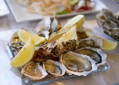 Fresh oysters in a plate with lemon by lerronando