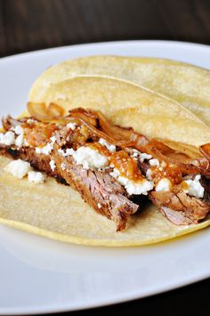 Chipotle Steak Tacos with Caramelized Onions and goat cheese melted atop which blends nicely with the flavors of meat.