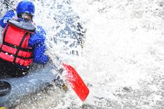 Person white water rafting in the Smoky Mountains
