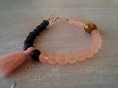 NEW ORLEANS Bracelet . black lava and peach beads bracelet. tassel bracelet by MerakibyStevie on Etsy