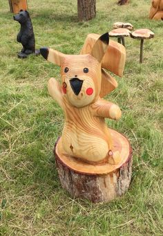 Chainsaw carved pikachu out of larch