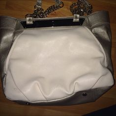 White and Silver J.Lo purse **Sorry for the horrible pictures :(** Used one time. Very stylish JLo purse. Lots of room inside and pockets outside! Jennifer Lopez Bags