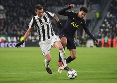 Mario Mandzukic of Juventus battles Dele Alli of Tottenham during the UEFA Champions League Round of 16 First Leg match between Juventus and Tottenham Hotspur at Allianz Stadium on February 13, 2018 in Turin, Italy.