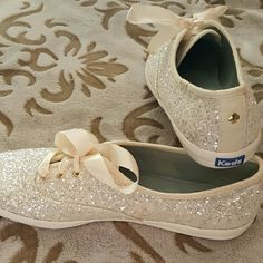Kate Spade for Keds, NWOT, Size 9, A stunning pair of white glitter Keds, completely designed for style and comfort. How adorable would these be worn under a wedding dress...perfect!?! Arrive with matching ribbon shoelaces.