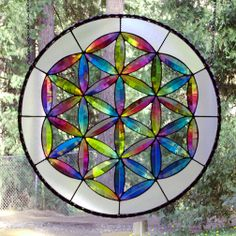The GRAND DADDY of all sacred geometry is the Flower of Life featuring 90 petals. There are other versions called the Seed of Life with 42 petals and the Fruit of Life with 24 petals.  I offer the panels for sale as well as a lesson plan/kit to make the dichroic glass bevels and jewels. contact me at askdichroglassman@yahoo.com