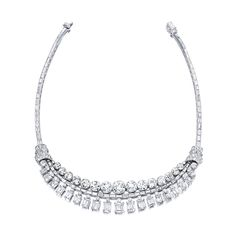 Diamond Necklace Designed as a graduated fringe of step- and circular-cut diamonds, embellished with diamond-set scroll motifs, the diamonds weighing approximately 70.00 carats in total, mounted in platinum, 1950s, length approximately 370mm.