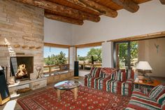 Love fireplace and rough hewn beams